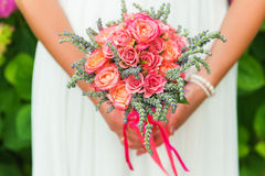 Bride holding wedding bouquet, close up Stock Images