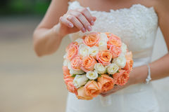 Bride holding wedding bouquet, closeup Stock Photos