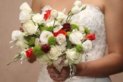 Bride holding the wedding bouquet closeup Stock Image