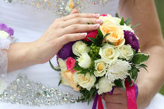 Bride holding wedding bouquet closeup Royalty Free Stock Images