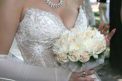 Bride holding wedding bouquet closeup Stock Images