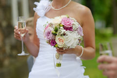 Bride is holding a wedding bouquet Royalty Free Stock Photos
