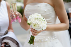 Bride is holding a wedding bouquet Royalty Free Stock Photo