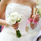 Bride holding a wedding bouquet Stock Photos