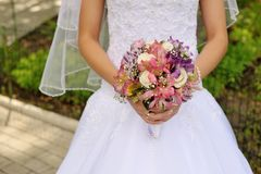 Bride holding a wedding bouquet in hand Stock Photography