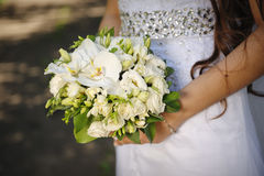 Bride holding a wedding bouquet in hands Stock Photos