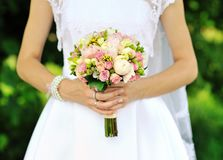 Bride holding wedding bouquet in hands royalty free stock photos