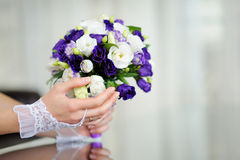 Bride holding wedding bouquet in her hand Stock Image