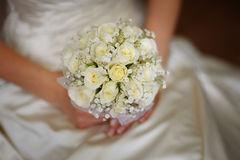 Bride holding wedding bouquet in her hand Royalty Free Stock Photos