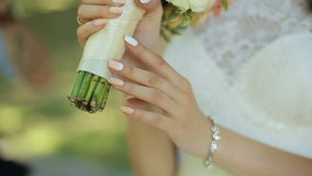 Bride holding wedding bouquet in her hands stock video