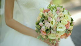 Bride holding wedding bouquet in her hands stock video footage