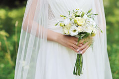 Bride holding wedding bouquet  - outdoor Royalty Free Stock Images