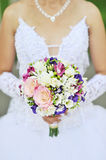 Bride is holding a wedding bouquet Royalty Free Stock Photography