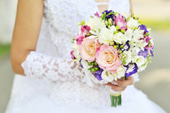 Bride is holding a wedding bouquet Stock Photography