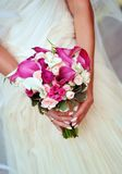 Bride holding wedding bouquet Stock Photography