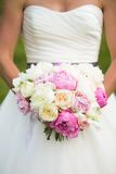 Bride holding wedding bouquet of pink and white flowers Royalty Free Stock Photography