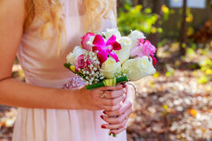 The bride holding wedding bouquet of pink and white roses Royalty Free Stock Photography