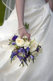 Bride holding a wedding bouquet Royalty Free Stock Image