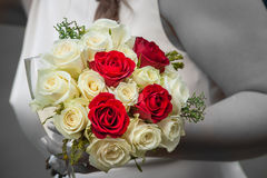 Bride holding a wedding bouquet of roses Royalty Free Stock Image