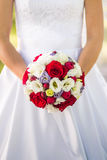 Bride holding wedding bouquet with roses Royalty Free Stock Photo