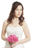 Bride holding a wedding bouquet smiling Royalty Free Stock Image