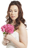 Bride holding a wedding bouquet smiling Royalty Free Stock Images