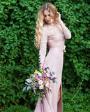 Bride holding the wedding bouquet with succulent f Royalty Free Stock Image