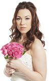 Bride holding a wedding bouquet thoughtful Royalty Free Stock Photo