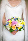 Bride holding a wedding bouquet. Wedding flowers Royalty Free Stock Image