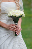 Bride is holding a wedding bouquet of white Stock Photo