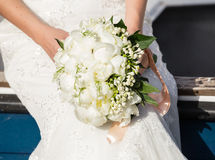 Bride holding wedding bouquet Stock Photos