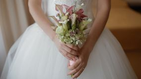 Bride holding wedding bouquet stock footage