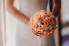 Bride holding a wedding bouquet Stock Images