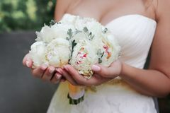 Bride is holding wedding bouquet Royalty Free Stock Images