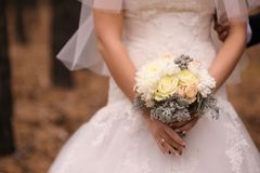 Bride holding wedding bouquet Royalty Free Stock Images