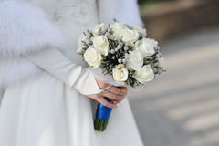 Bride Holding wedding Bouquet of White Roses Royalty Free Stock Images