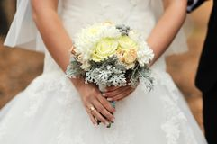 Bride holding wedding bouquet Royalty Free Stock Photos