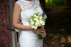 Bride holding wedding flower bouquet of roses. Royalty Free Stock Photos