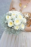 Bride holding wedding flower bouquet Stock Images