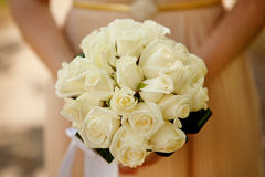 Bride holding wedding flower bouquet Stock Photo
