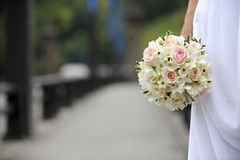 Bride holding wedding flowers Royalty Free Stock Photo