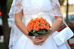 Bride holding wedding flowers Royalty Free Stock Photos