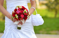 Bride holding wedding flowers Stock Photos