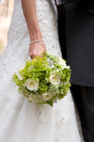 Bride holding wedding flowers Royalty Free Stock Images