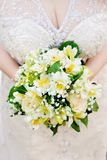 Bride holding wedding flowers bouquet. Bride holding beautiful yellow wedding flowers bouquet Royalty Free Stock Photography