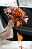 Bride holding wedding flowers bouquet Stock Image