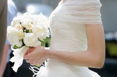 Bride holding wedding flowers bouquet. Closeup photo Royalty Free Stock Photos