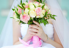 Bride holding wedding flowers bouquet Royalty Free Stock Photo