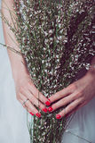 Bride holding wedding flowers Stock Images