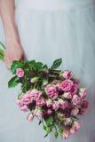 Bride holding wedding flowers Royalty Free Stock Image